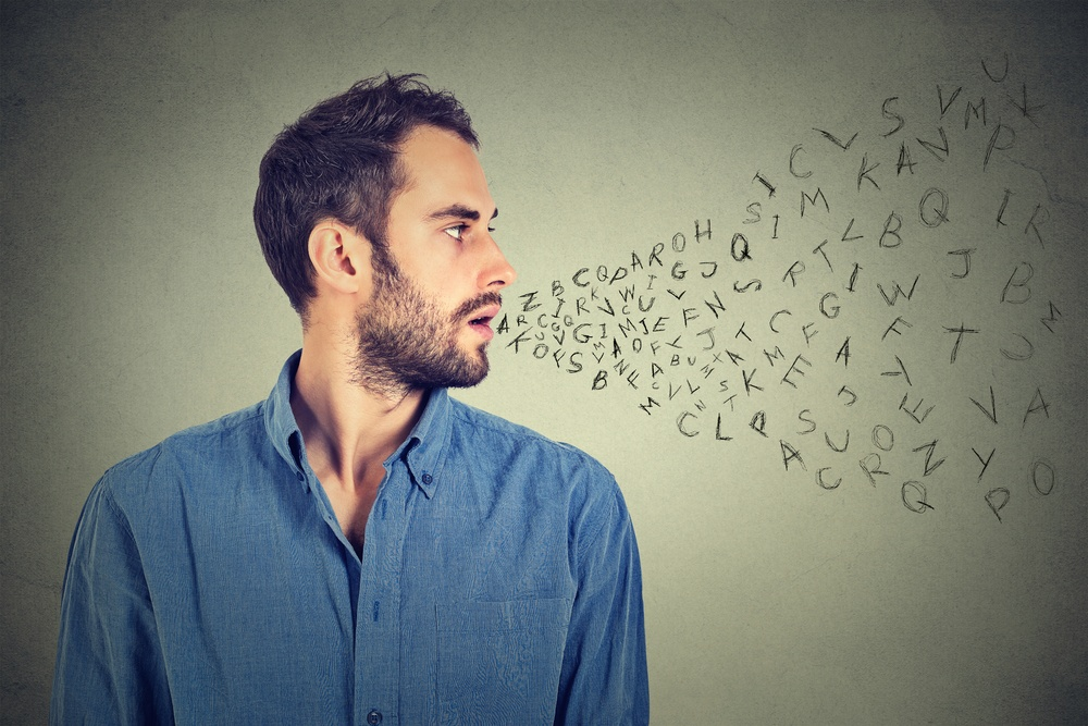 Man talking with alphabet letters coming out of his mouth. Communication, information, intelligence concept